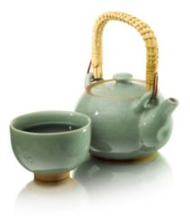 cup of green tea with tea pot