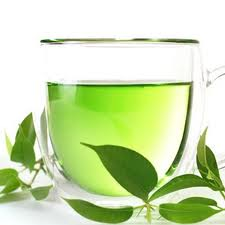 cup f green tea and tea leaves