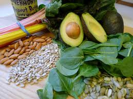 dark green leafy vegetables, seeds and nuts, and whole grains are rich on vitamin E